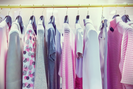 fashion: A row of clothes hanging on the rack Stock Photo