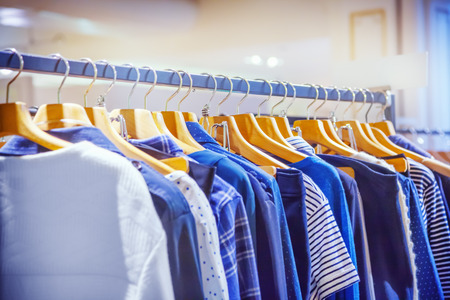 red cloth: A row of clothes hanging on the rack Stock Photo