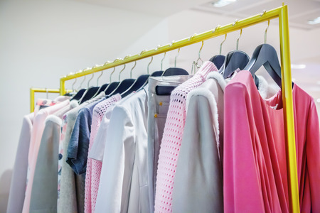 clothes rack: A row of clothes hanging on the rack Stock Photo