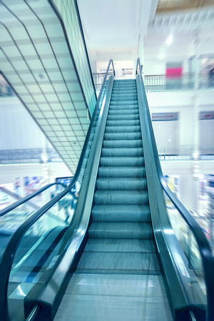 people in elevator: Escalator in a shopping mall