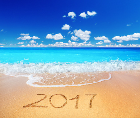 sandy beach: 2017 written on sandy beach Stock Photo