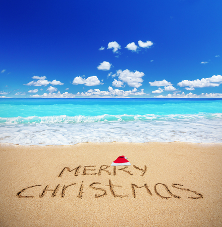 sandy beach: Merry Christmas written on a sandy beach