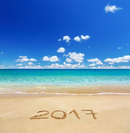 2017 written on sandy beach 写真素材