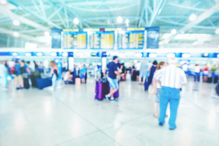 airport check in counter: Passengers in an airport