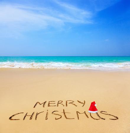 merry christmas written on a sandy beach stock photo 65765013 - Merry Christmas Beach