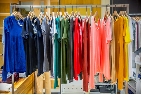 showwindow: A row of clothes hanging on the rack Stock Photo