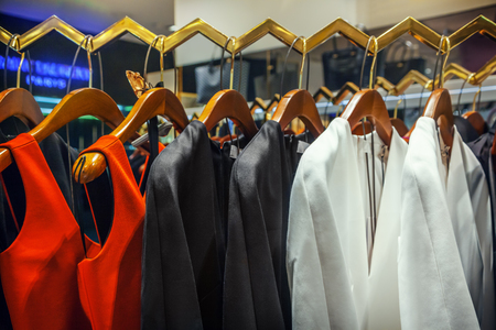 shopwindow: A row of clothes hanging on the rack Stock Photo