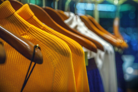 shirt hanger: A row of clothes hanging on the rack Stock Photo