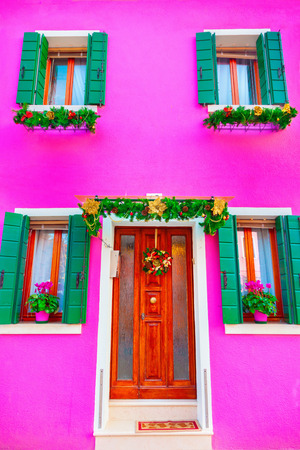 Pink house with christmas decoration on the island Burano, Venice, Italy Stock Photo