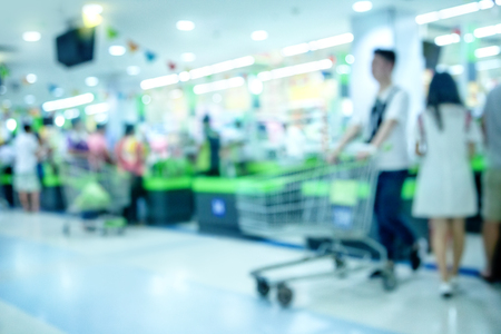 checkout: Blur checkout counter in supermarket Stock Photo