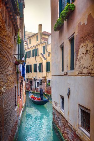Venice canal view with historical buildings.