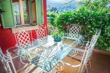 Garden furniture on terrace of suburban home