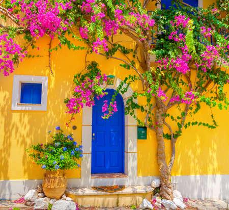 Old wooden door in Assos village in Kefalonia, Greece Stock Photo