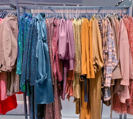 A row of clothes hanging on the rack Stock fotó