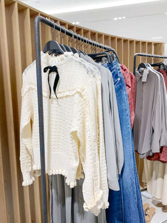 Clothes on hangers in a retail shop