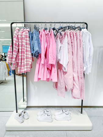 Clothes on hangers in a retail shop Stockfoto
