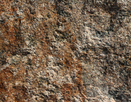 iron oxide: Broken stone surface close-up. Iron oxide coating.