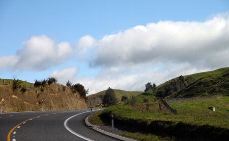 a turning on a beautiful and empty road, passing thru scenic village of New zealand photo