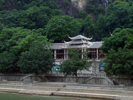 riverside tree: Beautiful entrance of the Chinese public garden by the side of the river