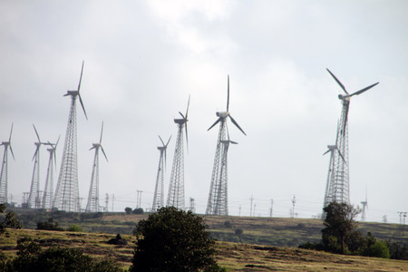 comprising: wind-farm comprising of many windmills running in full swing Stock Photo