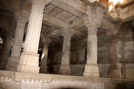 architecture monumental: Well carved pillars and other ruins of an ancient monumental architecture called Adalaj stepwell in India Stock Photo