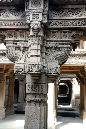 step well: An ancient monument caled Adalaj step well in the Gujarat State in India is full of beautiful carvings all around, including pillars, walls and windows