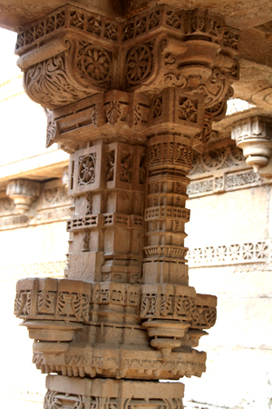 monument in india: a historic monument called Ajalaj step-well in the Gujarat State of India has many well carved pillars, adding to its beauty