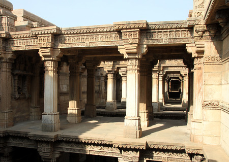 monument in india: A beautiful ancient monument called Adalaj step-well near Ahmedabad district of Gujarat State of India contains well carved walls and pillars. Entire structure is a superb piece of ancient architecture