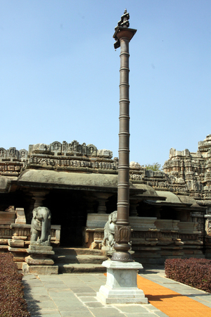 Front view of Veer Narayana temple in the State of Karnataka in India, along with religious tall pillar in the front