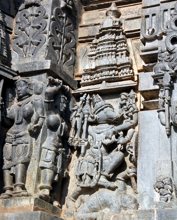 well equipped: Ancient temple at Halebidu in India has well crafted carvings on its walls. This carving is of Lord Ganesh equipped with arms in his multiple hands, crippling the demon under his leg