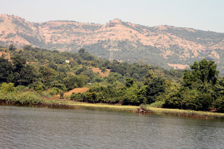 river county: Bank of a beautiful river by the side of hills and lots of green trees. Serenity at its best