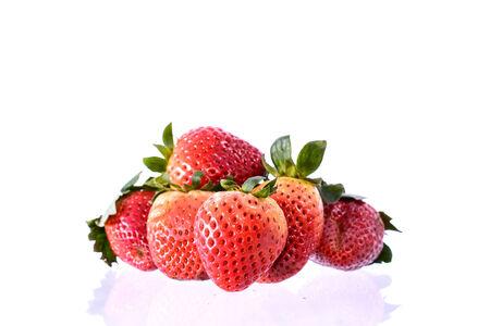 strawberies: Fresh strawberies on white background Stock Photo