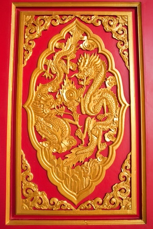 nonthaburi province: golden dragon decorated on red wood in chinese temple,Nonthaburi Province,Thailand Stock Photo
