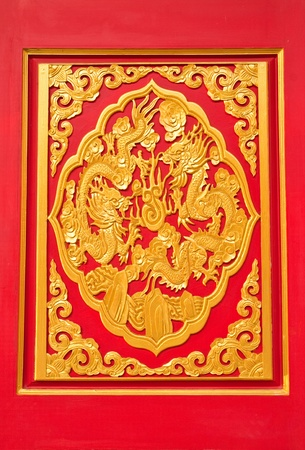 golden dragon decorated on red wood in chinese temple,Nonthaburi Province,Thailand photo