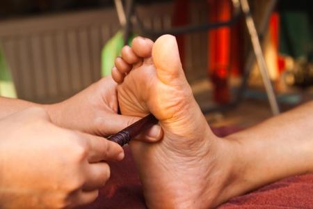 reflexology foot massage, spa foot treatment,Thailand Stock Photo - 8846894