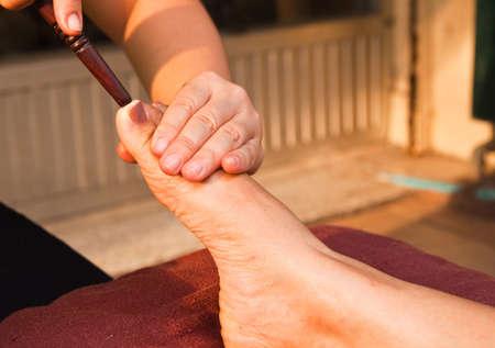 reflexology foot massage, spa foot treatment,Thailand Stock Photo - 8846892