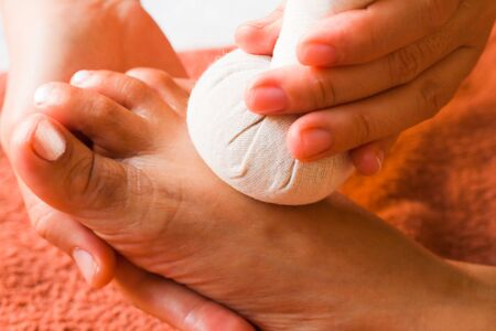 reflexology foot massage, spa foot treatment by ball herb,Thailand Stock Photo - 8929995