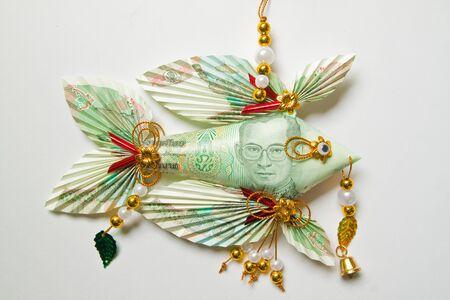 Thai banknote twenty bath folded into a fish,keep for lucky photo