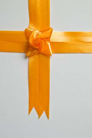 Beautiful orange bow on white background photo