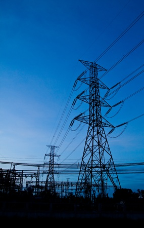 High voltage electricity pillars and blue sky in the morning photo