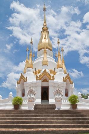 Golden Pagoda and blue sky in Wat Tham Khuha Sawan,Ubonratchathanee Province, Thailand. Stock Photo - 9637401