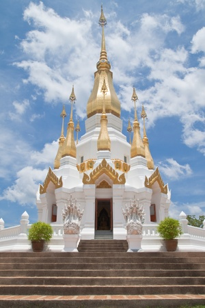 grand pa: Golden Pagoda and blue sky in Wat Tham Khuha Sawan,Ubonratchathanee Province, Thailand.