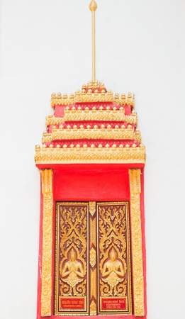 Golden Wood Carving ,Traditional Thai Style at the window of church in Thai Temple. Stock Photo - 9637440