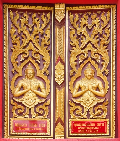 Golden Wood Carving,Traditional Thai Style in Thai Temple. photo