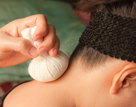 reflexology neck massage, spa the neck treatment by ball-herb,Thailand Stock Photo - 9749875