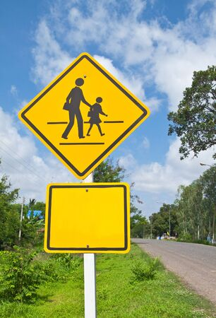 Traffic sign (School warning sign) and blue sky. photo