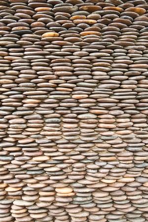 Close up of circle pebble wall,abstract background photo
