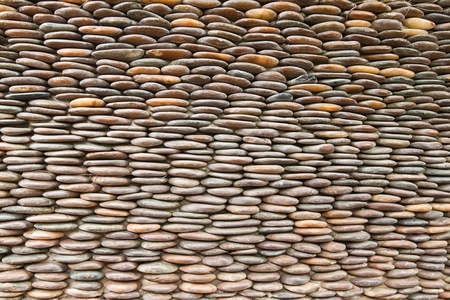 Close up of circle pebble wall,abstract background photo