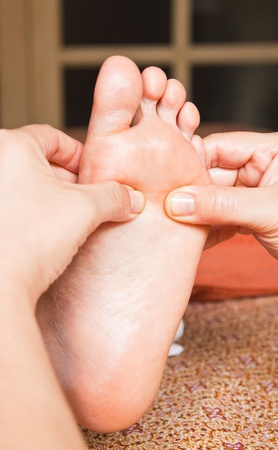traditional healer: reflexology foot massage, spa foot treatment,Thailand