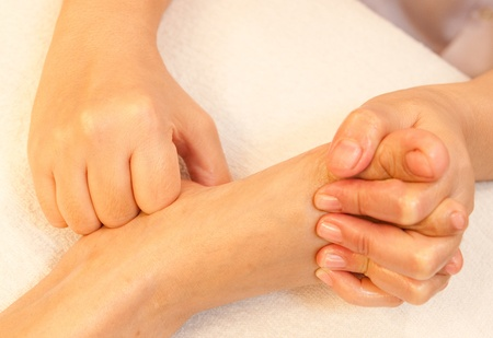 reflexology foot massage, spa foot treatment,Thailand Stock Photo - 10416667